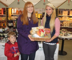 Grace at The Apple Tree Farm Shop presenting Sarah Guest with her hamper