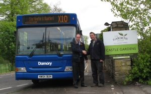 Adam Keen, operations manager at Damory and Mike Burks, managing director of The Gardens Group at the new bus stop on New Road.