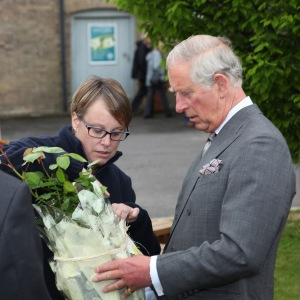 Lucy Simpson, manager at Poundbury Gardens, presents HRH The Prince of Wales with an old fashioned yellow shrub rose, named Charlotte. Picture credit: Neil Crick ARPS